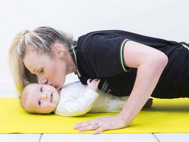 "GOOD FIT: Meg Dougherty from Yamba Physiotherapy does some ""baby push-ups"" with her 10-week-old daughter Poppy as she refines her Mums and Bubs fitness program."