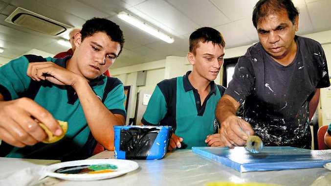 CREATIVE: Khyle Tucker, Moura and Josh Holloway, Rockhampton, with Sunshine Coast aboriginal artist Arthur Conlon.