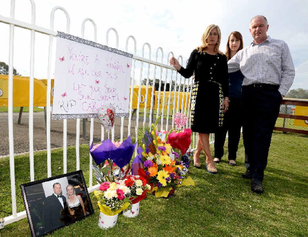 TRIBUTE: Lisa Stevens (AJA Critical Incident consultant), Rachael Jones (Racing Queensland) and Des O'Keeffe (GM Australian Jockeys Association Victorian Branch) at a memorial to Carly-Mae Pye.