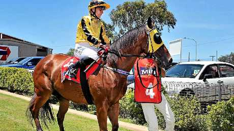 Carly-Mae Pye returns to scale on Rhino after a win at the Gladstone Turf Club.
