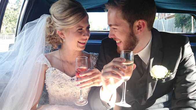 CELEBRATORY CLINK: Rockhampton's Hannah and Colin Ferguson look forward to a happy marriage together.
