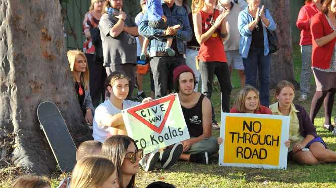 PROTEST: Some of the people who rallied on Wednesday against putting a road through Pioneer Park.