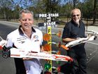 STARTERS UP: Queensland Model Drag Racing Association member Stewart Low (left) and president Martin Armstrong prepare for some fast track action at the Carole Park drag strip this weekend.