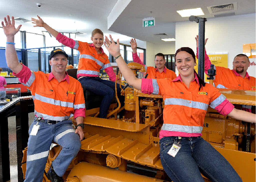 IN THE PINK: Hastings Deering supervisor Mark Farmer (left) and Brodie Moohin, Paul Morrell, Stacey Gardner and Andy Watson model the high-vis wear specially created for the company to raise funds for breast cancer.