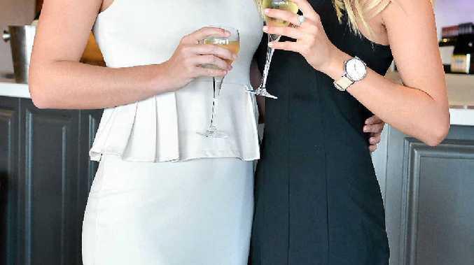 FINE FORM: Tori de Jong and Nicole Brugman model Melbourne Cup fashions ahead of Drift Bar's big race event.