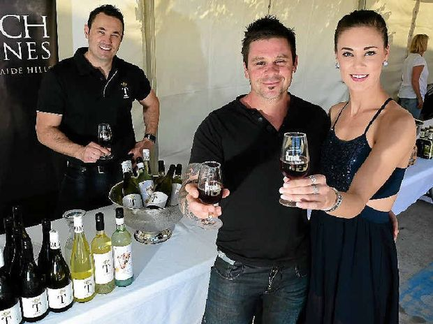 WORTHY CAUSE: Sam Tomich with Erica Cecchin and Tony Kelly take part in The Creek Tavern's Great Wine Challenge, a fund- raiser for brain tumour sufferer, two-year-old Braxton Rayner, of Dalby (pictured).