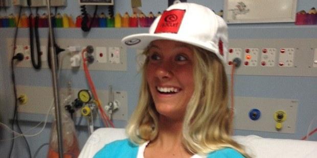 Kirra-Belle Olsson was bitten on the ankle by a metre-long shark.