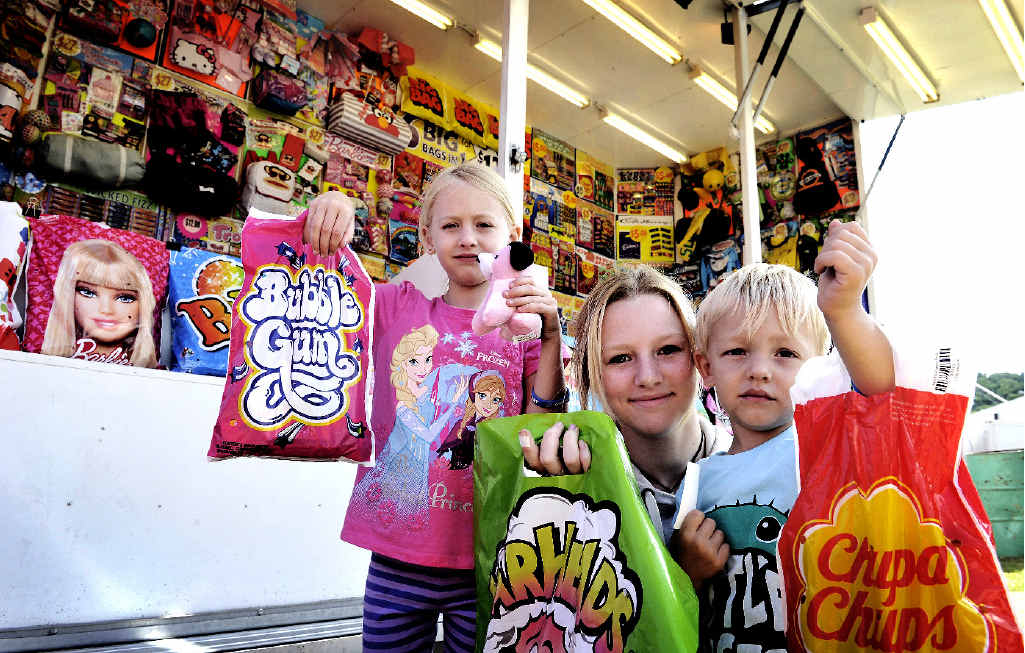 Mackenzie Murphy, 6, Natahlia Murphy, 15, and Cohen Dietrich, 3, all of Casino, celebrate their take in the showbags.