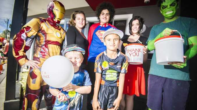 Zayden Sewell, 3 and Kyaan Sewell, 6 with superheroes Noelle Cavanagh, Kahlia Spencer, Xavier Singh, Nickki Gibbs and Devdan Sidnu at McHappy Day celebrations at the Gladstone Central McDonald's.