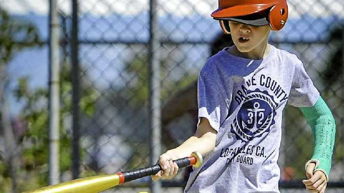 DETERMINED: Young tee-baller Nate Beach enjoys himself at Memorial Park.
