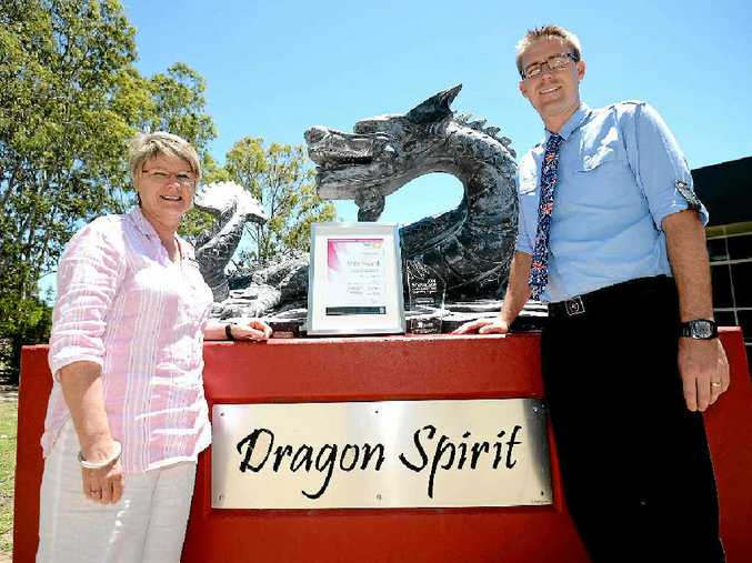SPIRIT OF SUCCESS: Glenmore High principal Janet Young and deputy Matt Newell are celebrating after the school's Dragon Spirit Program was awarded at the Showcase Awards for Excellence in Schools.