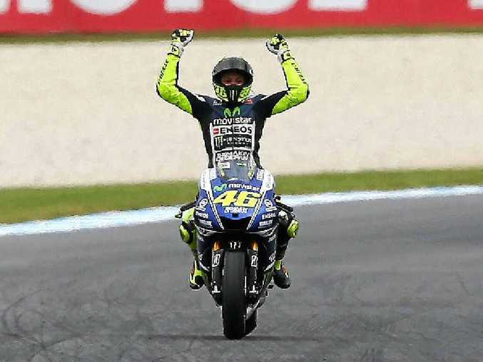 TURNING BACK THE CLOCK: Valentino Rossi celebrates his MotoGP win at Phillip Island.