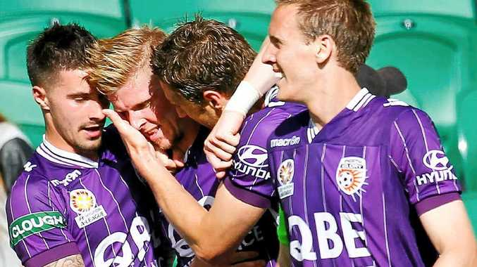 HAPPY DAYS: Andy Keogh (second left) celebrates with Perth Glory teammates after scoring a goal against the Brisbane Roar.