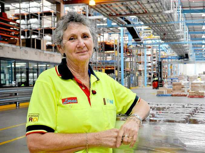 DEDICATION: Lorna Tucker retired after 18 years and one month working at the Big W Distribution Centre. She was farewelled on Friday with a large gathering of her colleagues sad to see her go.