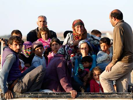 Syrian Kurdish refugees after crossing into Turkey from Kobani.