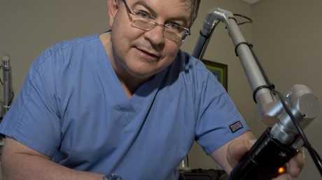 Dr Eddie Roos performs a procedure