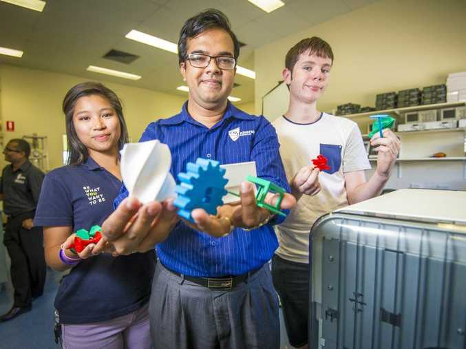 First year engineering student Xela Pil, School of Engineering and Technology lecturer Ashfaque Chowdhury and second year Matt Benson are thrilled with the news of the extension of the engineering degree in Gladstone.