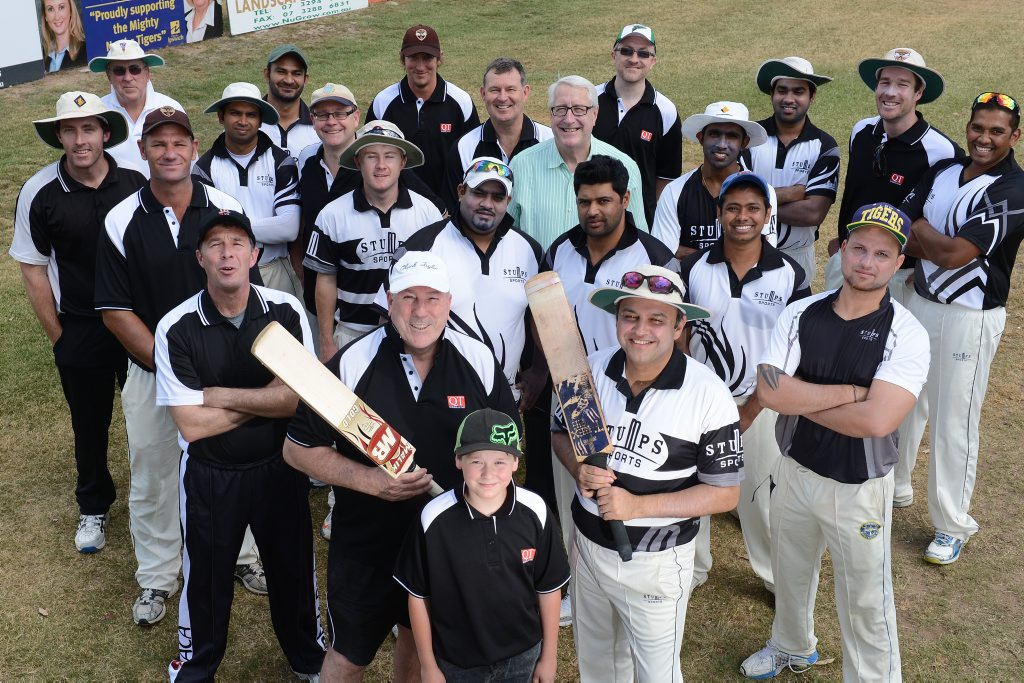 PITCH PERFECT: Team captains Peter Chapman and Raj Sharma with youngest player Patrick Gorrel and the rest of the participants in the T-20 Harmony Shield cricket match.