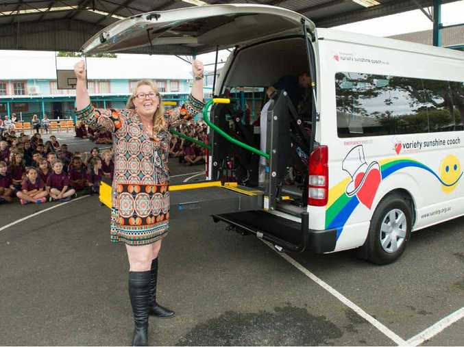WELCOME VEHICLE: A delighted Janelle Bullen takes delivery of the Sunshine Variety Coach.