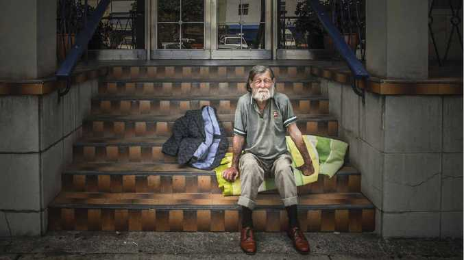 SLEEPING ROUGH: Robert Draper, known as Blanket Bob, sets up camp in the doorway of a Grafton business.