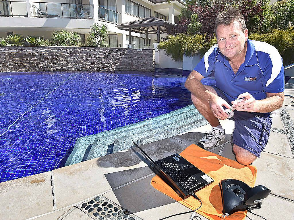 Greg McGarry from PoolWerx testing the water at the Allegra Mercure apartments.
