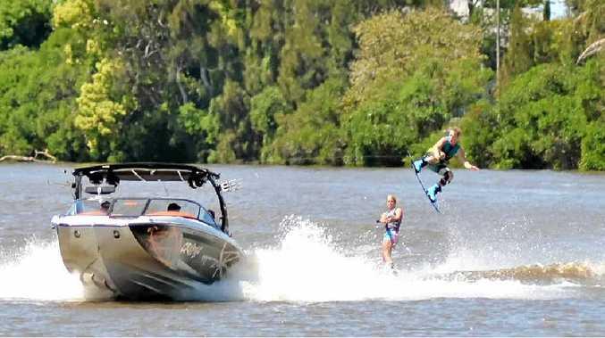 FLYING HIGH: Nick Crisp, 18, of Glen Innes, jumps over Georgia Sellings, 14, as part of the waterski display at the Woodburn Riverside Festival.