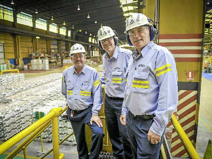 SAFETY MILESTONE: Boyne Smelters Ltd manager metal products Nigel Mullen, general manager operations Joe Rea and operations manager Kevin Taylor in the metal products area of the smelter.