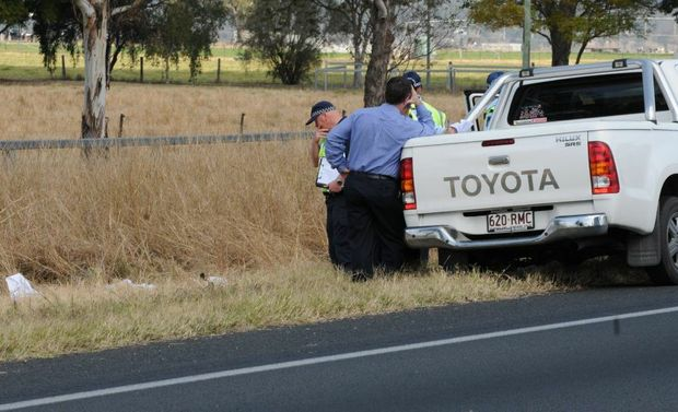 Police investigate the hit and run death of 25-year-old man Shui Ki Chan beside the Warrego Hwy near Gatton in August 2012.
