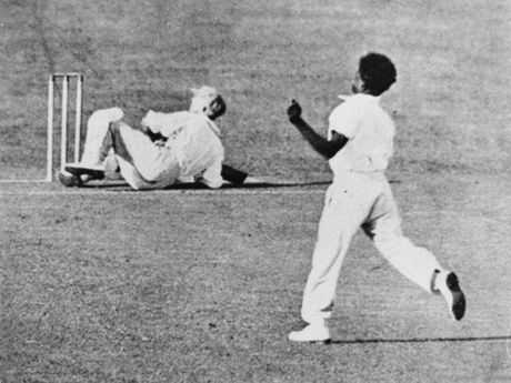 Queensland bowler Eddie Gilbert puts Donald Bradman on his backside during a Sheffield Shield match in 1931. Photo: Contributed