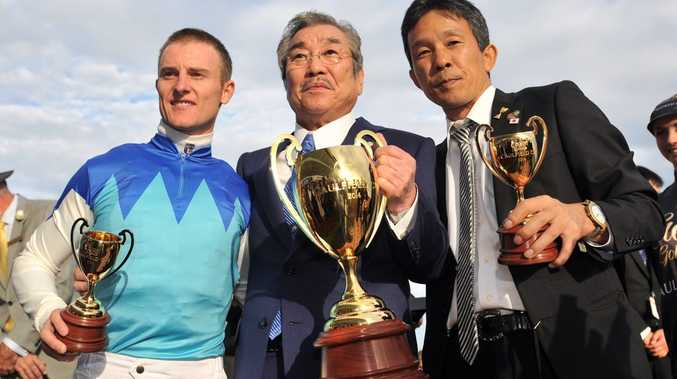 RIDING HIGH: Zac Purton joins owner Riichi Kondo and trainer Tomoyuki Umeda to celebrate winning the Caulfield Cup with Japanese horse Admire Rakti. Photo: AAP IMAGE (NO RESALE)