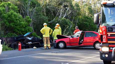 2 vehicle collision closes David Low Way at Peregian Beach and entraps a woman in her vehicle. Photo Geoff Potter / Noosa News