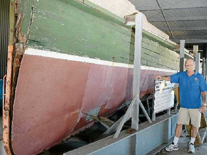 Ron Creber, curator manager of the Ballina Naval and Maritime Museum, with the riverboat MV Florrie, parts of which will be renovated.