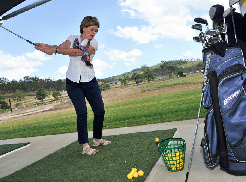 TRYING GOLF: Whitsunday Regional Council Mayor Jenny Whitney swings a club at the Regatta Waters golf driving range.