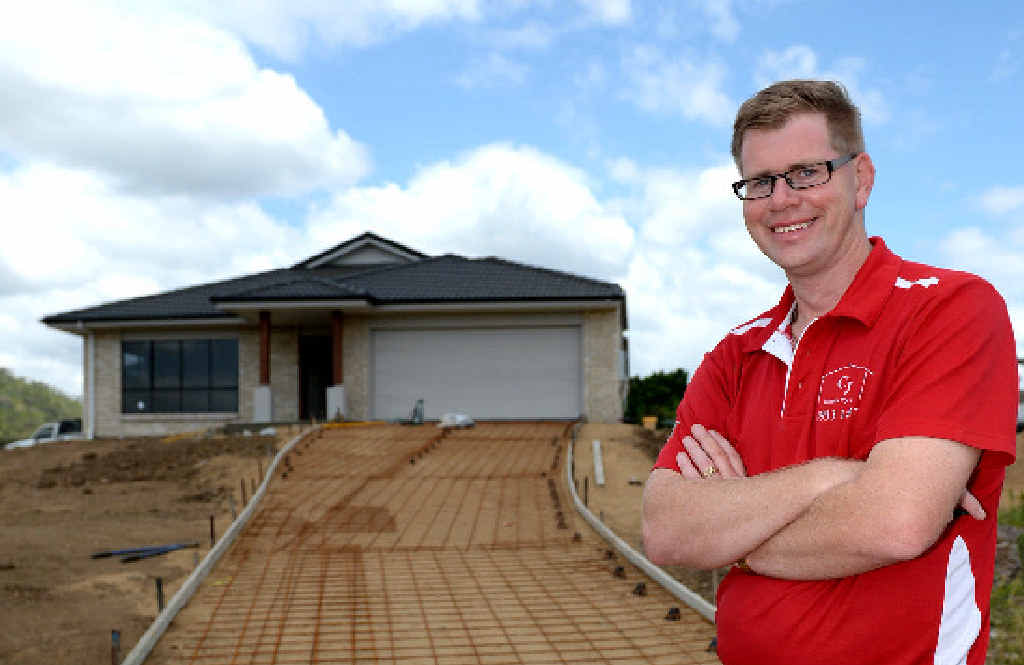 ON A ROLL: CJ Home's sales consultant Steven O'Hanlon doesn't agree with others that the building industry is suffering, with CJ Homes building a record number of homes this year.