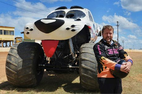 BRING IT ON: Gympie Times editor Craig Warhurst suits up before getting behind the wheel of one of the monster trucks yesterday ahead of Saturday night's big event.