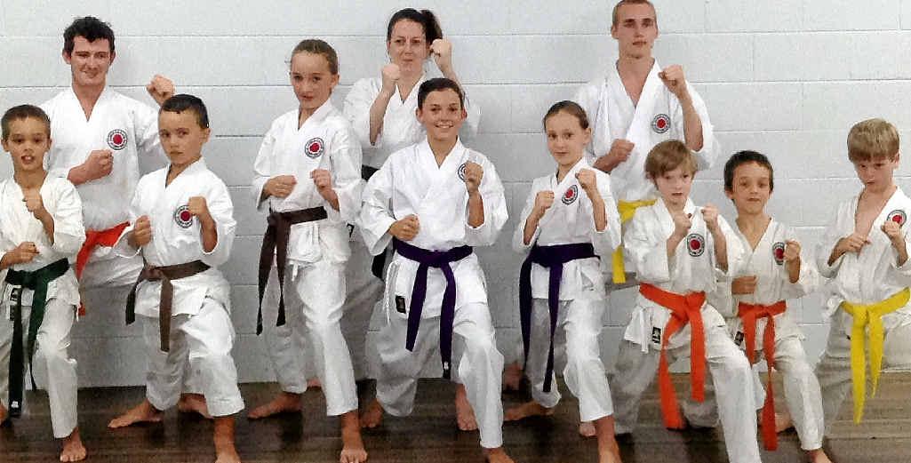 PASSING THE TEST: Eleven Gympie Karate Club members passed their grading last week (back, from left) Lee Kearney (6 Kyu Green Belt), Wendy Brown (5 Kyu Blue Belt), Tristan Warren (Orange Belt), (front, from left) Samuel Hinds (5 Kyu Blue Belt), Kyle Vollmar (1 Kyu Brown Belt), Emma Vollmar (1 Kyu Brown Belt), Abby Schooth (3 Kyu Brown Belt), Kleo Isaac (3 Kyu Brown Belt), Kaleb Inskip (6 Kyu Green Belt), Timothy Hinds (6 Kyu Green Belt) and Carter Senini (7 Kyu Orange Belt).
