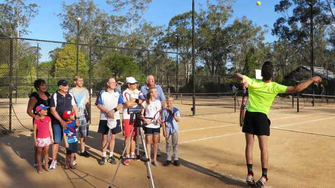 WHO'S FASTER?: Players and spectators watch the speed of their serves using Tennis Ipswich Inc's new radar gun. Pictured is Hayden Welge recording the fastest serve of the afternoon at 161kmh.