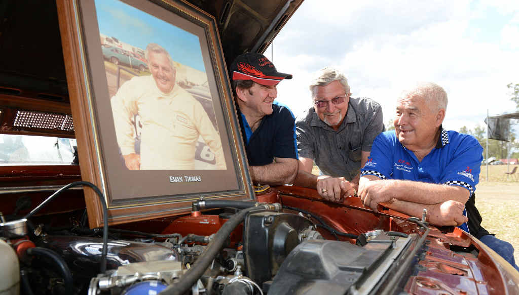 FINE TRIBUTE: Long-serving Ipswich West Moreton Auto Club member Don Powell (middle) chats to current club vice-president Kevin Parkes (left) and president John Connell about the work of Evan Thomas in the club's early days.