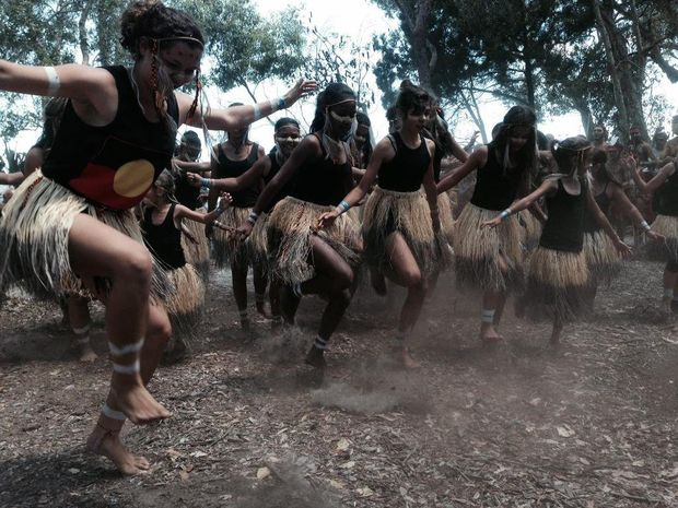 Aboriginal dancers perform on Fraser Island ahead of the Federal Court sitting.