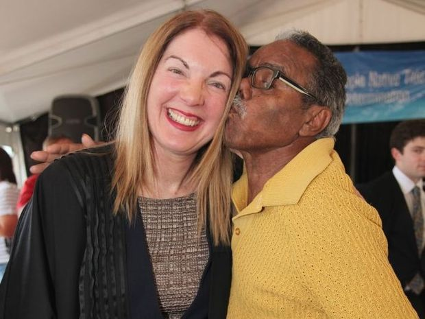 Justice Berna Collier from the Federal Court of Australia receives a kiss from Butchella elder Malcolm Burns after the Butchulla people were officially recognised as the traditional owners and native title holders of Fraser Island during a ceremony at Kingfisher Bay Resort on October 24.