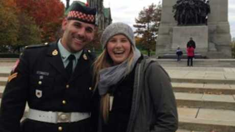 Tourist Megan Underwood posed with Corporal Cirillo before he was shot. Photo: Megan Underwood / Facebook.