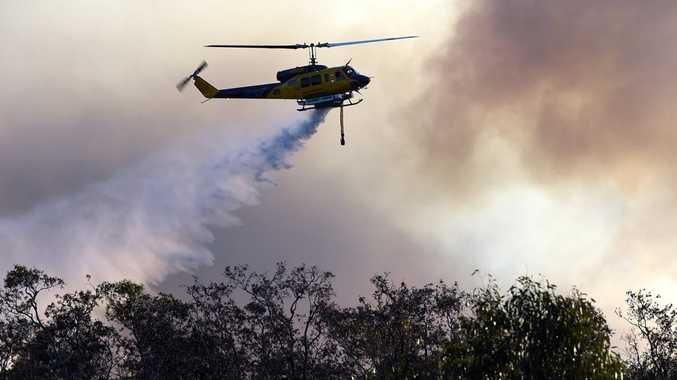 Water bombing helicopters battle the bushfire burning near Bestmann Rd, Ningi, on Saturday, October 25, 2014. Photo Jorge Branco / Caboolture News
