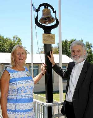 MEMORIES: Woodburn's St Joseph's Primary School principal Jeanette Wilkins and Parish priest Richard Foley with the bell to commemorate past and future students during the centenary celebrations.