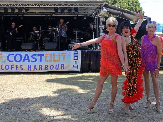 Lovely ladies (from left) Carol, Daisy May and Gloria point revellers in the right direction to a fun weekend at Coast Out.