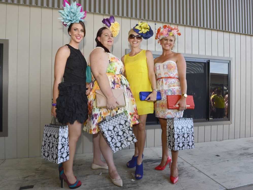 Lauren Neill (best fascinator), Kristy Gifford (3rd overall), Kate Butcher (2nd overall) and Kellie Bebendorf (1st place) at the Cox Plate Fashions on the Field at Ferguson Park, Gladstone.