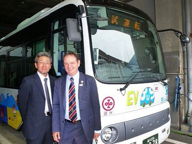 INNOVATIVE PLAN: Mayor Paul Pisasale with Nomura Research Institute senior researcher Daisuke Yajima in front of an electric bus.