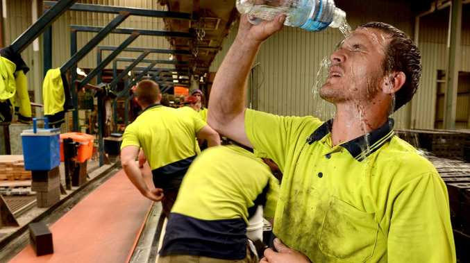 One of the hottest places to work in Ipswich today is in Claypave in Dinmore. Beau Sadler tries to cool down as production slows down and regular drinks breaks are taken.