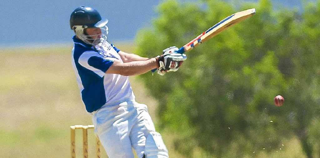 PUT AWAY: Brothers' Terry Sawyer during the Gladstone Brothers' match against Capricorn Coast at Clinton Oval.