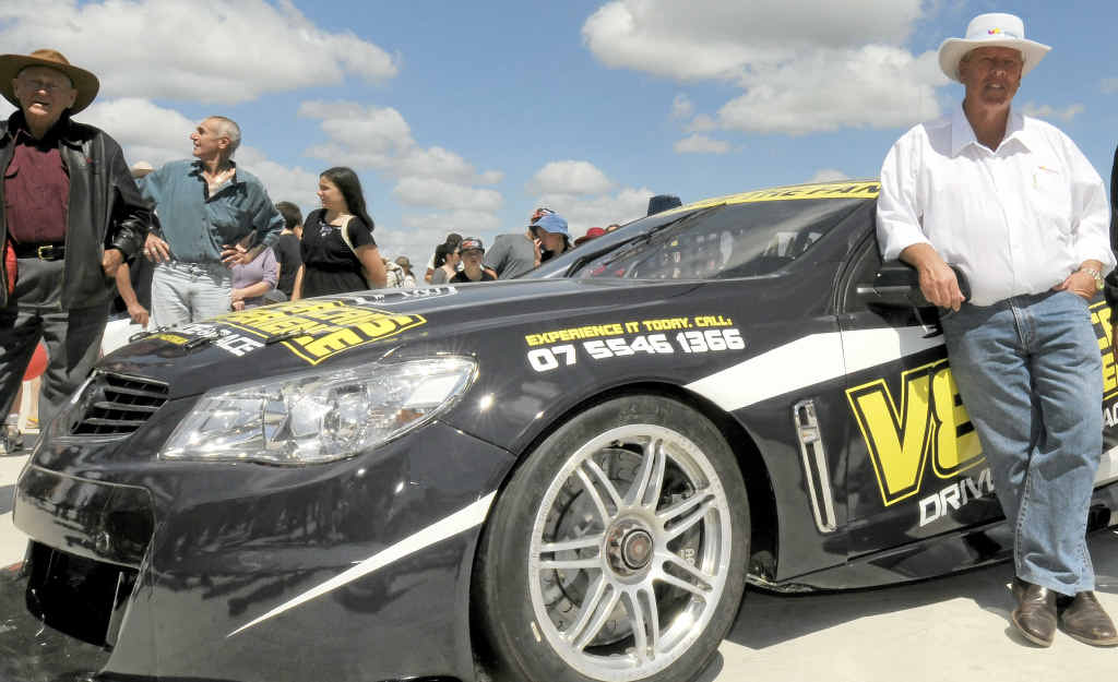FAST CARS: John Wagner checks out a V8 Supercar at the Brisbane West Wellcamp Airport open day last month.