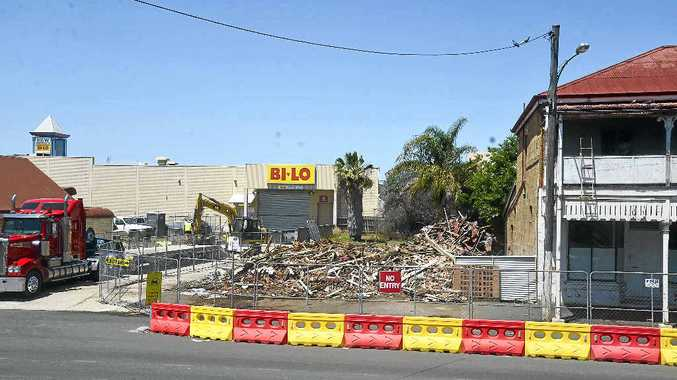 HISTORY GONE: The scene on Fitzroy St yesterday. 84 Fitzroy St (at right of photo) will be restored.